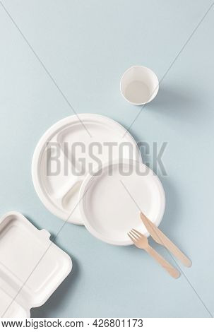Plastic-free Disposable Tableware Top View, Vertical. Paper Plate, Food Containers, Glass, Wooden Fo