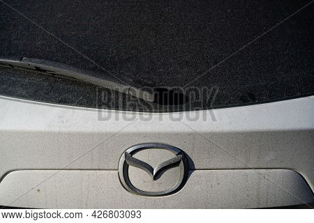 Irkutsk, Russia - July 10 2021: Close Up Dirty Mazda Car With A Wiper On The Back Window. Do Not For