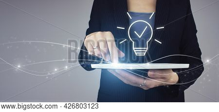 Creative Idea.concept Of Idea And Innovation. White Tablet In Businesswoman Hand With Digital Hologr