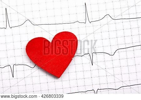 Printed ECG, as background, red heart