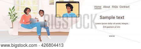 Woman And Little Son Discussing With Husband In Web Browser Window Self-isolation Virtual Meeting