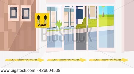 Office Corridor With Signs For Social Distancing Yellow Stickers Coronavirus Epidemic Protection Mea