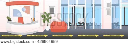Lobby Entrance Reception Desk With Signs For Social Distancing Yellow Stickers Coronavirus Epidemic