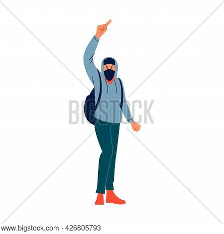 Youth Anarchist Man In A Dark Hood And Mask Demands Change, Stands In A Pose Against The Authorities