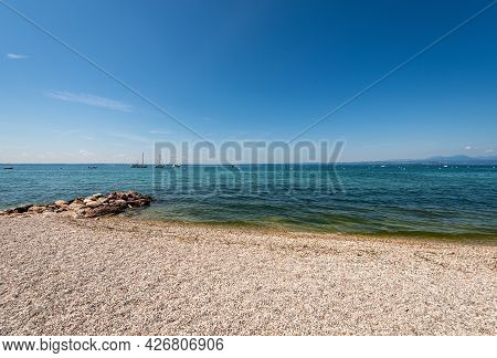 Beautiful Beach On Lake Garda (lago Di Garda) Between The Small Villages Of Cisano And Bardolino. Ve