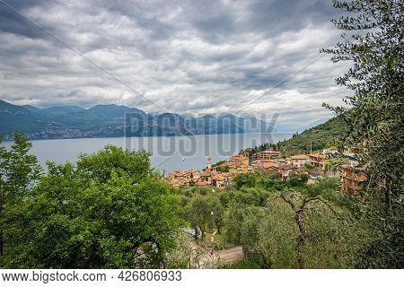 Aerial View Of The Lake Garda (lago Di Garda) With The Small Village Of Castelletto Di Brenzone, Bre