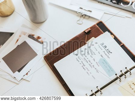 Daily planner on a messy desk