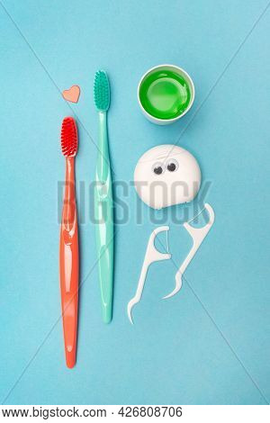 Teeth Hygiene And Oral Dental Care Products. Morning Concept. Dental Floss. Vertical. Blue Backgroun