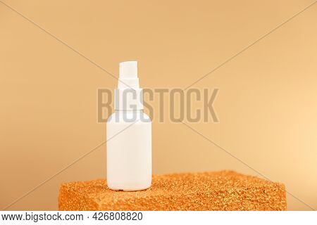 Unbranded White Cosmetics Spray Bottle On Golden Podium On Gold Background. Front View, Mockup. Cosm
