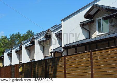 A View Of A Semi Detached House, Duplex Apartments, 6 Unit Multi-plex House Behind The Fence.