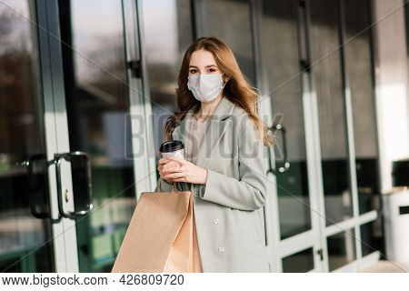 Young Female Wearing Mask For Prevent Virus With Shopping Bags On Narrow Street In Europe.
