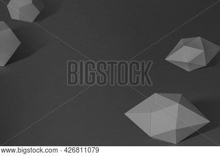 3D dark gray elongated hexagonal bipyramid and gray pentagon dodecahedron design element