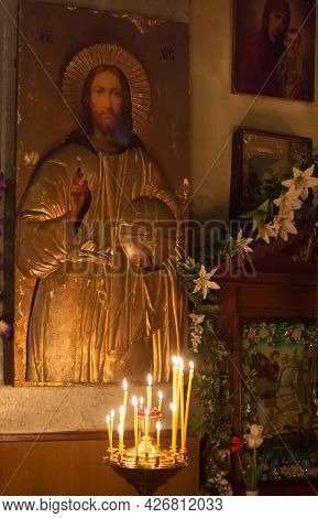 Gomel - May 4: Interior Of Russian Orthodox Church. Candles Under The Ancient Icon Framed With The G