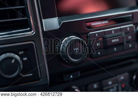 Car Radio Front Volume Close-up. Modern Car Audio System. Car Radio Controls