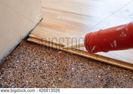Applying Sealant To Parquet Before Laying The Floor