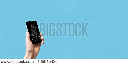 Male Hand Holding Digital Transparent Rocket Icon.startup Business Concept. Rocket Is Launching And
