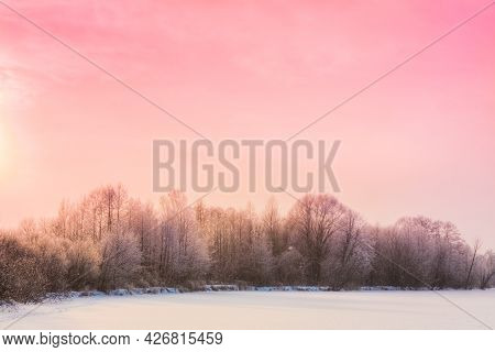 Landscape With A Winter Forest And Sundown