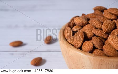 Tasty Organic Peeled Almond Snack In Wooden Bowl On White Wooden Background With Copy Space.close Up