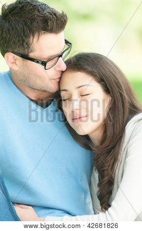 Young happy couple in love relaxing outdoor.
