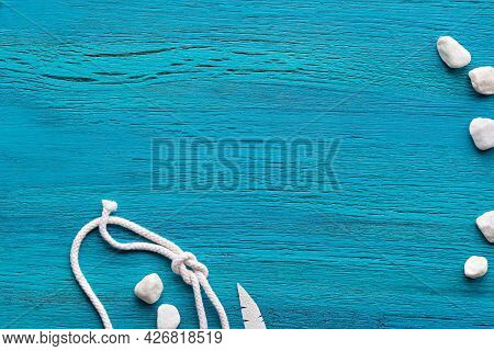 Abstract Grungy Mint Blue Wooden Background With Sailors Knot On Rope, Exotic Paper Leaves And White