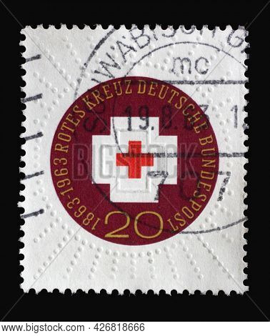ZAGREB, CROATIA - SEPTEMBER 03, 2014: Stamp printed in Germany shows 100th Anniversary of International Red Cross, Centenary of Red Cross series, circa 1963