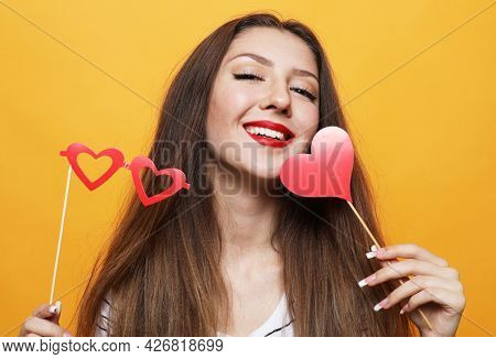 lifestyle, party and people concept: playful young woman ready for party
