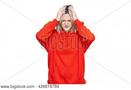 Young blonde girl wearing casual clothes suffering from headache desperate and stressed because pain and migraine. hands on head.