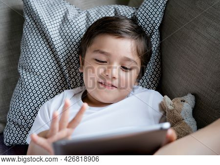 School Boy Studying, Learning Online Lesson At Home, Happy Child Playing Game Or Watching Cartoon On