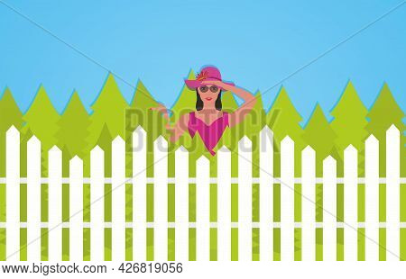 Curious Neighbour Looks Over The Fence. Woman Looking Over Fence To Garden, Spying, Jealosy, Gossip