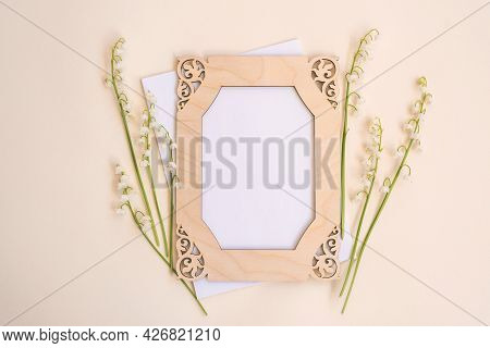 Fresh Lilies Of The Valley Twigs Decorative Wooden Frame And Blank Card With Space For Design On Bei