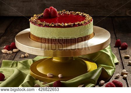 Pistachio Cheesecake With Raspberry Jelly On Cake Stand