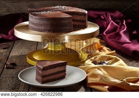 Sliced Chocolate Sponge Cake With Buttercream Topped With Ganache