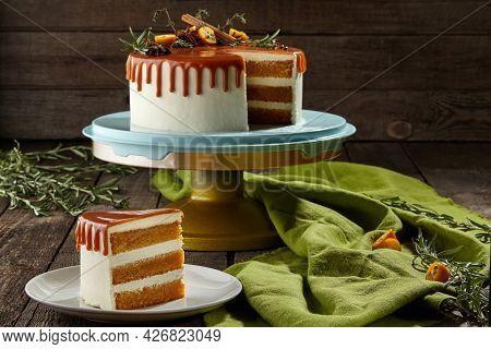 Sliced Honey Cake With Mascarpone Cream And Caramel Topping