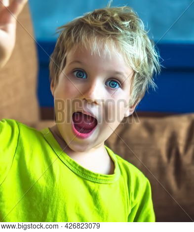 Portrait Mischievous Cute Blond Blue Eyed Boy Making Freckles Face Play Laughing In Happy Mood. Funn