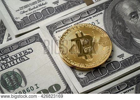 Siny Golden Bitcoin Coin Over Dollar Bills With Copy Space