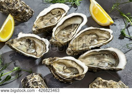 Fresh Raw Oysters In Shells Halves With Lemon