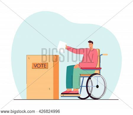 Disabled Person On Wheelchair Putting Voting Paper In Ballot Box. Handicapped Man At Polling Station
