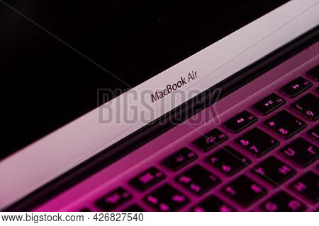 Moscow, Russia. July 13, 2021. Mac Book Air Close-up In Purple Lighting.