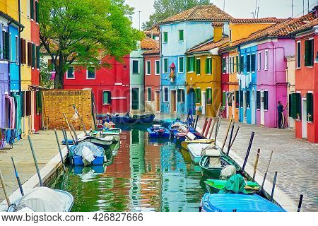 Venice, Italy - October 06, 2001: View Of Canal And Colorful Boats And Houses In The Burano Island,