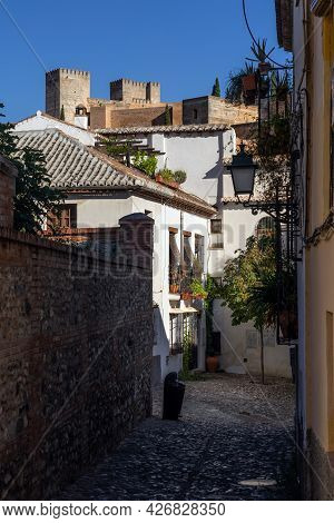 Typical White Streets In The Historic Neighborhood Of Albaicin In The City Of Granada At Sunset With
