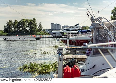 Sailing Yachts, Motorboats And Boats Moored To The Pier On The Yacht Club