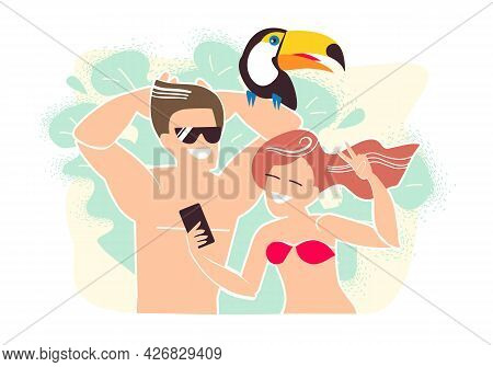 Couple Of Young People On Vacation Makes A Selfie With A Toucan Bird. Summer Vacations And Online Co