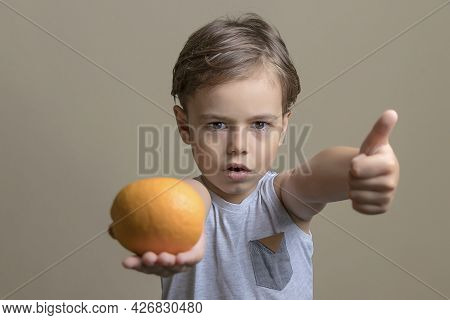 A Serious And Handsome Boy Holding A Ripe, Sweet, Juicy Orange And Showing A Thumbs Up. A Talking Ch