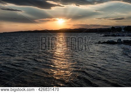 Beautiful Sunset Over Calm Sea On Beach Landscape. Sunset - Sunrise Seascape With Gentle Waves In Ca