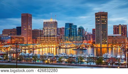 View on Baltimore skyline and Inner Harbor from Federal Hill at dusk
