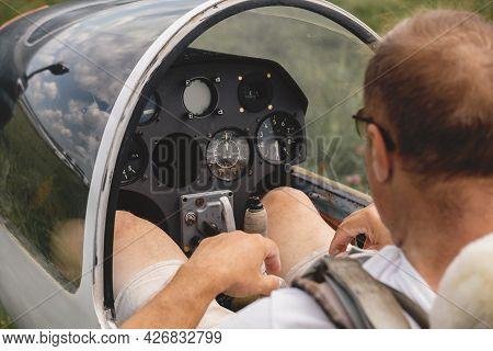 Pilot Prepares For Flight And Checks The Aerometric Instruments Altimeter Artificial Horizon Heading