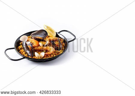 Traditional Spanish Seafood Paella Isolated On White Background. Copy Space
