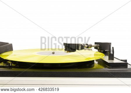 Close Up Of Turntable Needle Over A Vinyl Record. Turntable Playing Music. Stylus Over Rotating Yell