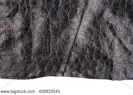 Piece Of Black Artificial Leather Isolated On White Background. Fake Alligator Skin.