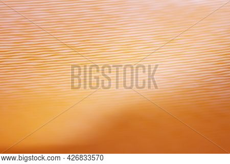 Macro Shot Of Orange Vinyl Record. Surface Of An Old Vinyl Record. Shallow Deph Of Field. Selective